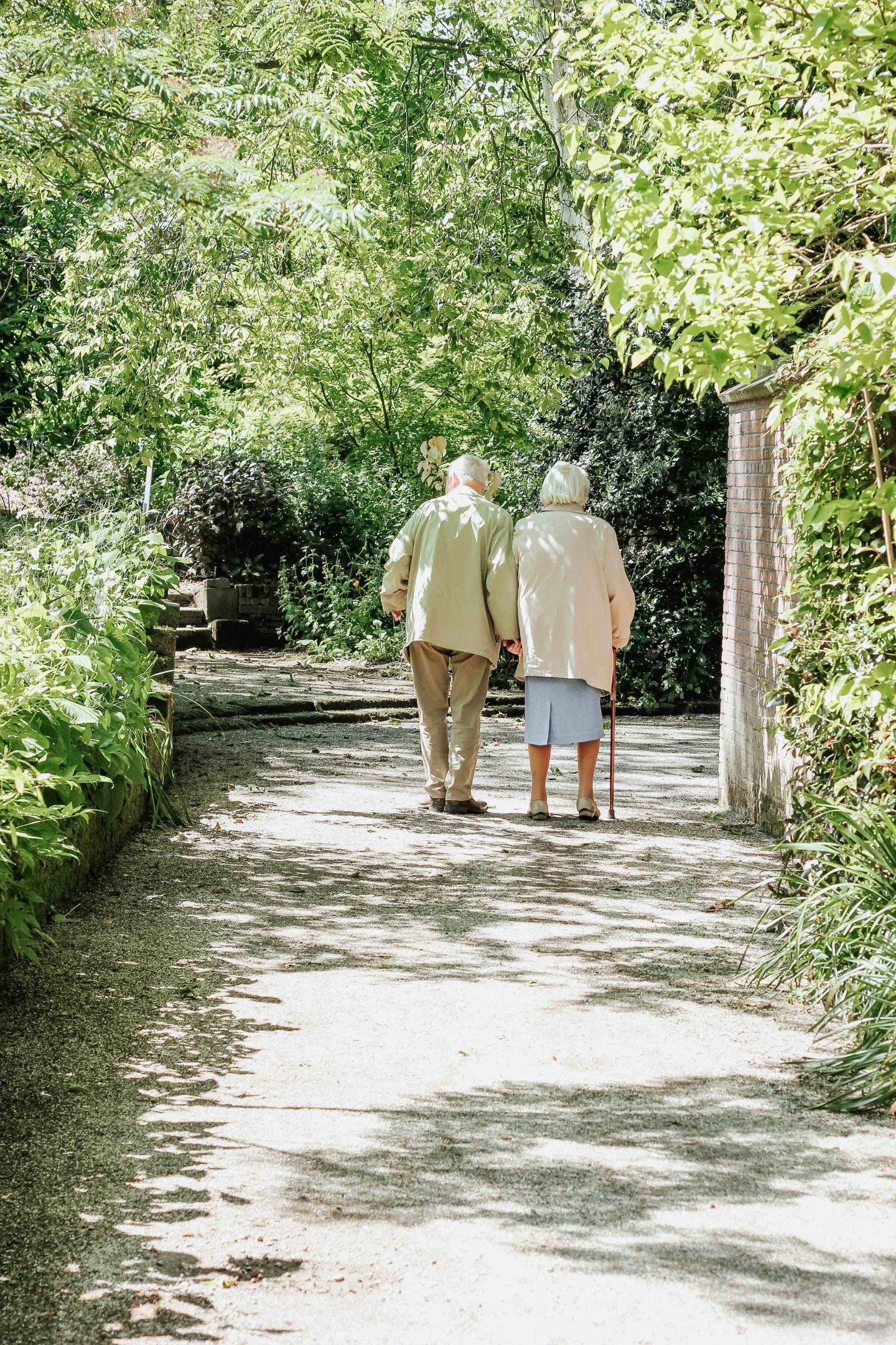 elderly couple walking in the neighborhood